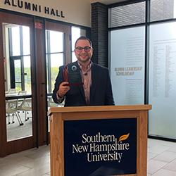 Jeff holding award at podium