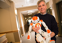 Dr. Lundy Lewis and a humanoid robot