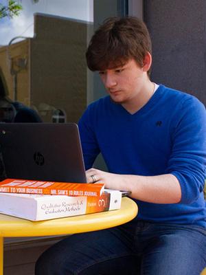 Walmart employee studying with SNHU online